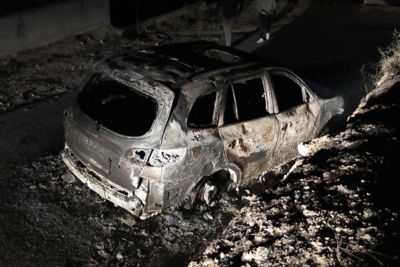 Сгоревшая машина подозреваемых.