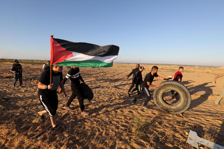 палестинские подростки у границы Газы, июнь 2021